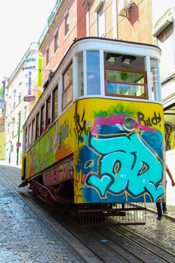 Lisbon has fun yellow trolley cars and amazing graffiti everywhere